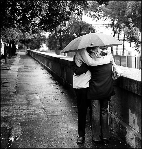 Romantic Couple In Rain