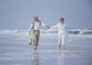 old-couple-walking-on-beach-300x211