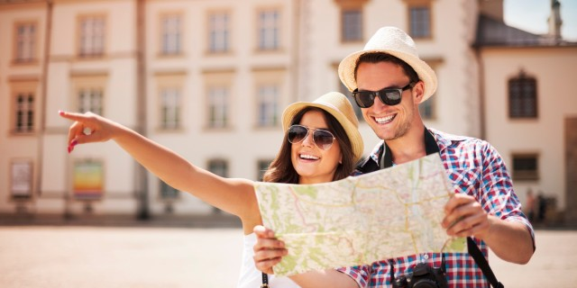 Happy tourist sightseeing city with map from The Huffington Post